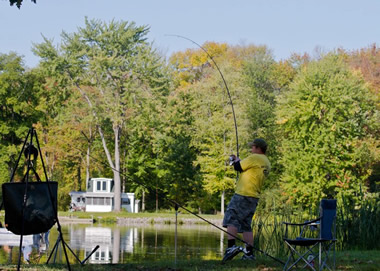 Jason Bernhardt reeling in a carp during Session 5. Liverpool, NY