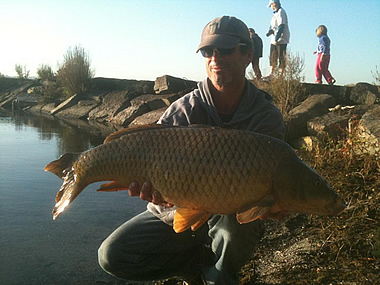 Paul Russell with a 25.0 lb common caught during Session 5 of the Wild Carp Club of Central NY. Liverpool, NY