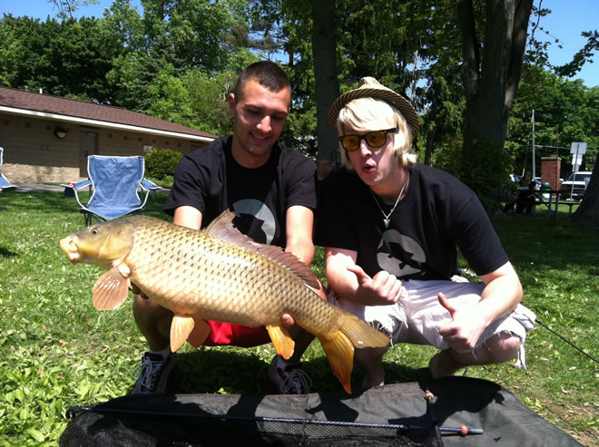 Ivan Petrov (left) and celebrity partner Wade Live (right) celebrate their 12 lb carp caught shortly after the conclusion of the 2012 JGB Celebrity Carp Challenge in Baldwinsville, NY.