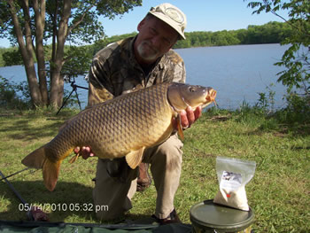 Club Director Gilbert Huxley with a common carp caught in IN