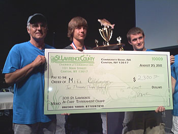 Michael Cummings receives his $2,300 check for winning the 2011 St. Lawrence Jr. Carp Tournament