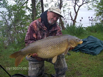 Wild Carp Club of Indiana Director Gilbert Huxley with another fine common carp