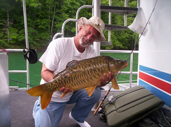 Wild Carp Club of Indiana Director Gilbert Huxley with another nice mirror carp caught at Dale Hollow Lake in TN